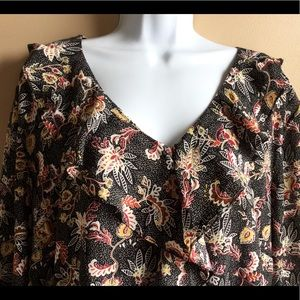 Multicolored  blouse with ruffled neckline.